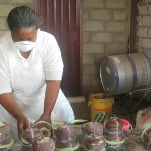 Makisha woman making bed posts, fiberglass process