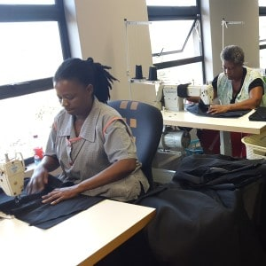 Muthande woman sewing